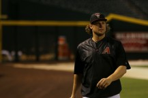 Diamondbacks infielder/outfielder Kyle Jensen walks along the warning track during batting practice before his team's game against the Dodgers on Thursday, September 15, 2016 at Chase Field. (Photo by Matt Layman/Cronkite News)